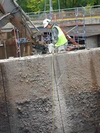 Cutting down railway foundation with Pentruder 3P8 HF-wire saw